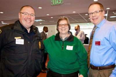Employees enjoy a service anniversary recognition reception.