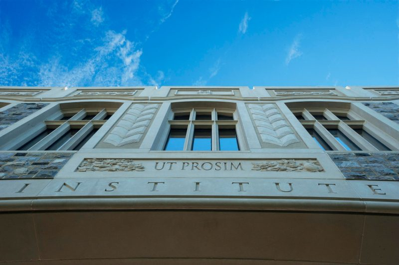 Scenic photo of campus showing Ut Prosim wording